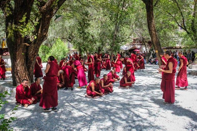best monasteries in Lhasa Tibet Sera Monastery Monk Philosophy debate