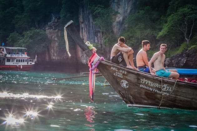 Long Tail Boat and Tourists in South Thailand