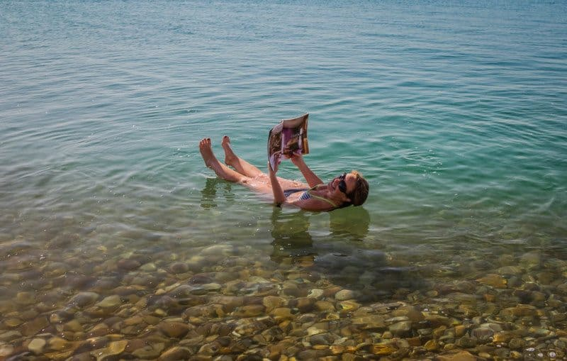 Reading a Magazine while floating in the Dead Sea Jordan